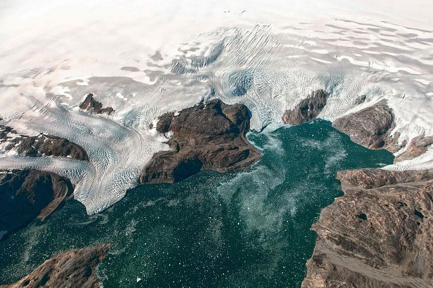 A Nasa Earth Observatory photo taken on Sept 22 last year shows the Bruckner and Heim glaciers where they flow into Johan Petersen Fjord in Greenland. Sea ice in both the Arctic Ocean and around Antarctica is currently at record lows for mid-January,