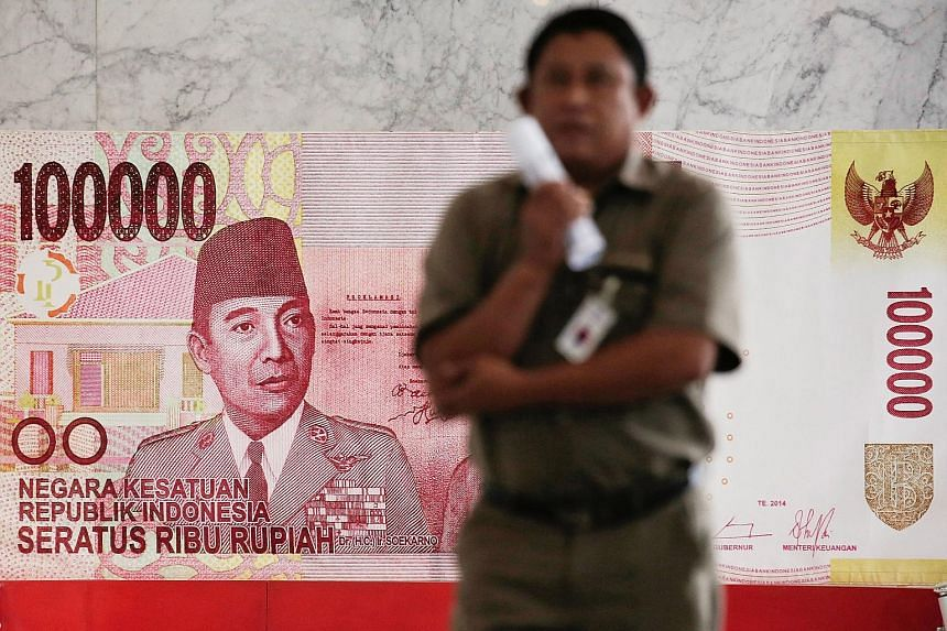 A poster of a rupiah note inside Indonesia's central bank, Bank Indonesia, in Jakarta. The prospect of further policy tightening in the United States is putting pressure on the rupiah, while room for more rate cuts by BI has shrunk with rising global