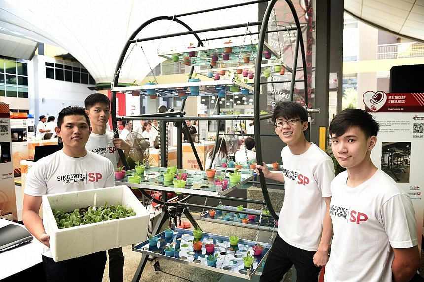 (From far left) Singapore Polytechnic students Tan Gim Yeow, Tan Yi Xuan, Chua Yong Chuan and Louis Szeto Hao Xuan with their urban farming kit, a multi-tiered rotating pot holder that allows more plants to be grown in a given space. WATCH THE VIDEO