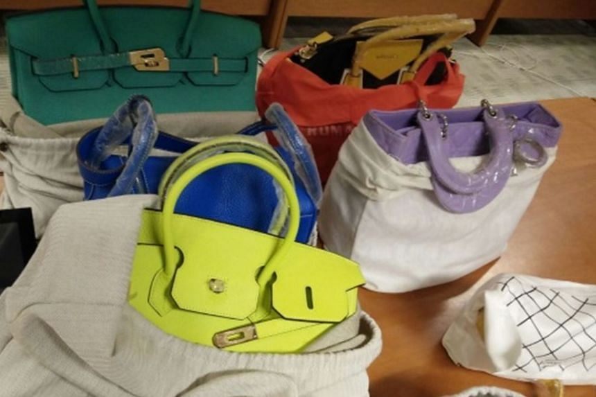 Two women were nabbed for selling counterfeit luxury goods including bags, shoes and clothes on Jan 19, 2017.