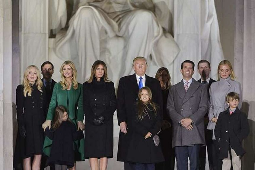 Donald Trump and family at Lincoln Memorial on pre-inauguration day - Barron was conspicuously missing.