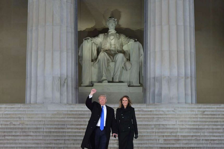 Donald Trump and his wife Melania arrive to attend an inauguration concert at the Lincoln Memorial in Washington, DC.