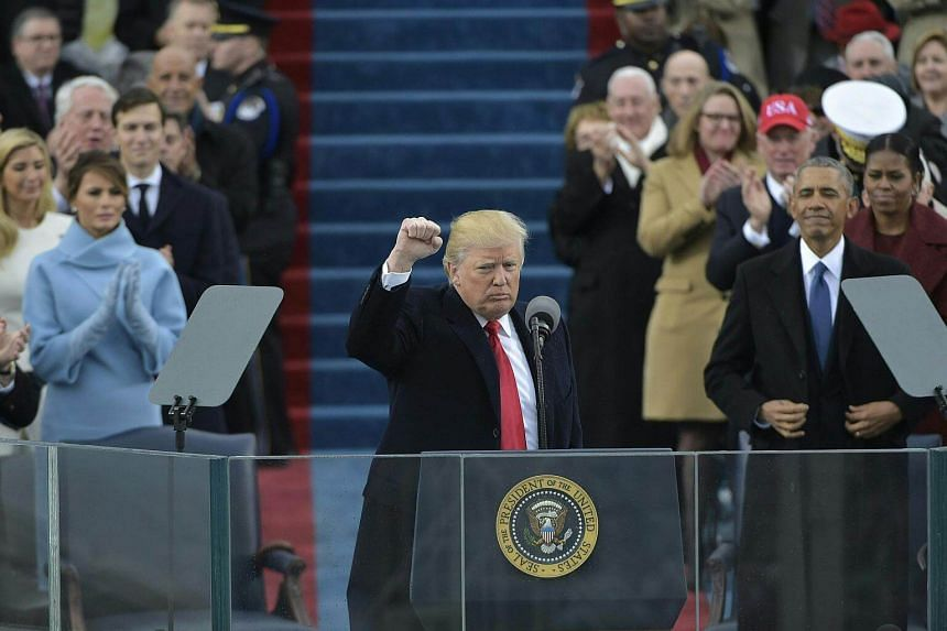 US President Donald Trump pumping his fist after addressing the crowd during his swearing-in ceremony, on Jan 20, 2017, at the US Capitol in Washington, DC.