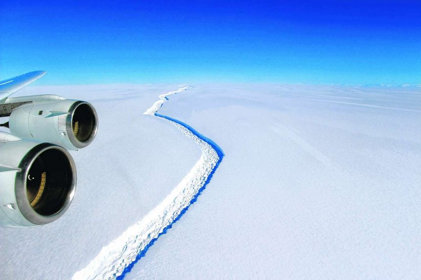 A Nasa photo shows a view of a massive rift in the Antarctic Peninsula's Larsen C ice shelf,  Nov 2016.