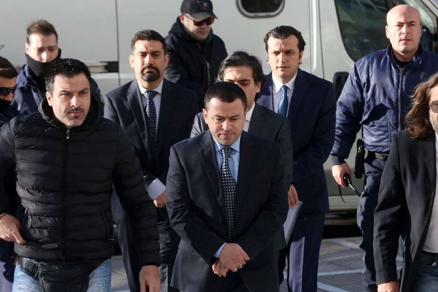 Turkish military officers escorted by Greek plainclothes police officers, as they arrive at Athen's Supreme Court for their hearing concerning their possible extradition over July's failed coup in Turkey, on Jan 13, 2017.