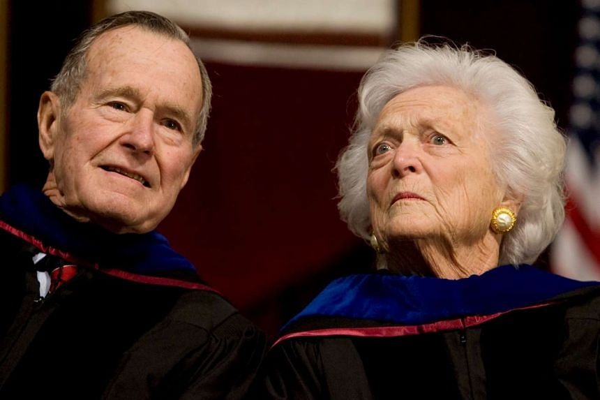 Former President George H.W. Bush (left), and former first lady Barbara Bush attend the Texas A&M University commencement ceremony in College Station, Texas, on Dec 12, 2008.