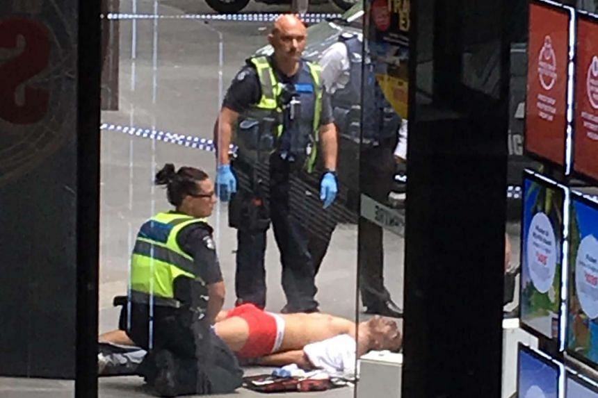 Police officers with a man, believed to be the driver of a car that has reportedly hit pedestrians, in Bourke Street Mall in Melbourne, Australia, on Jan 20, 2017.