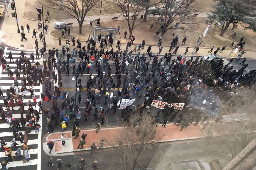 Protesters are seen on Jan 20 morning at an intersection in downtown Washington.