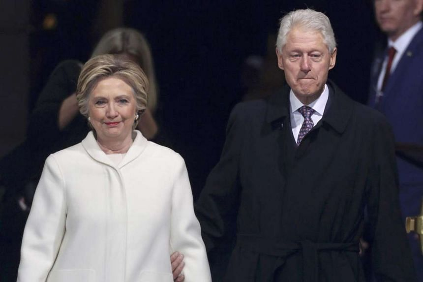 Former president Bill Clinton (right) and former Democratic presidential candidate Hillary Clinton arrive at inauguration ceremonies swearing in Donald Trump.