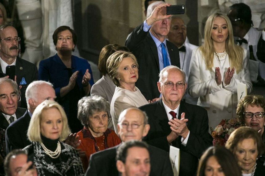 Hillary Clinton watches as President Donald Trump arrives at the Inaugural Luncheon, Jan 20, 2017.