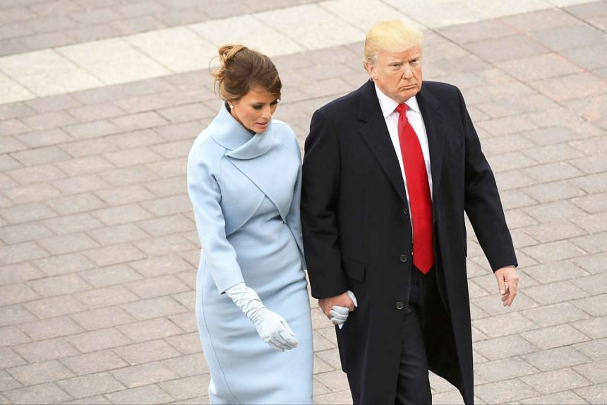 President Donald Trump and Melania Trump walk back after escorting former President Barack Obama and Michelle Obama to Marine One, Jan 20, 2017.