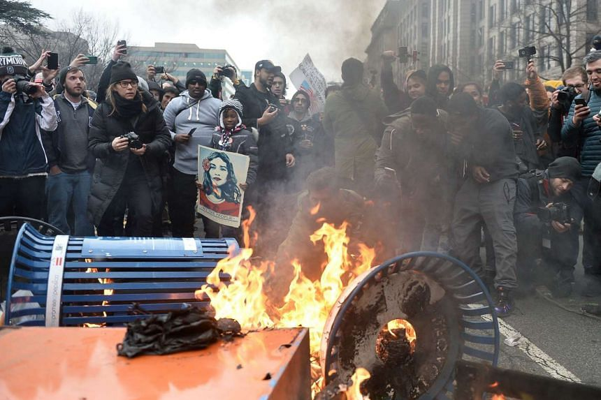Protesters set fires in protest against the inauguration of President Donald Trump, Jan 20, 2017.