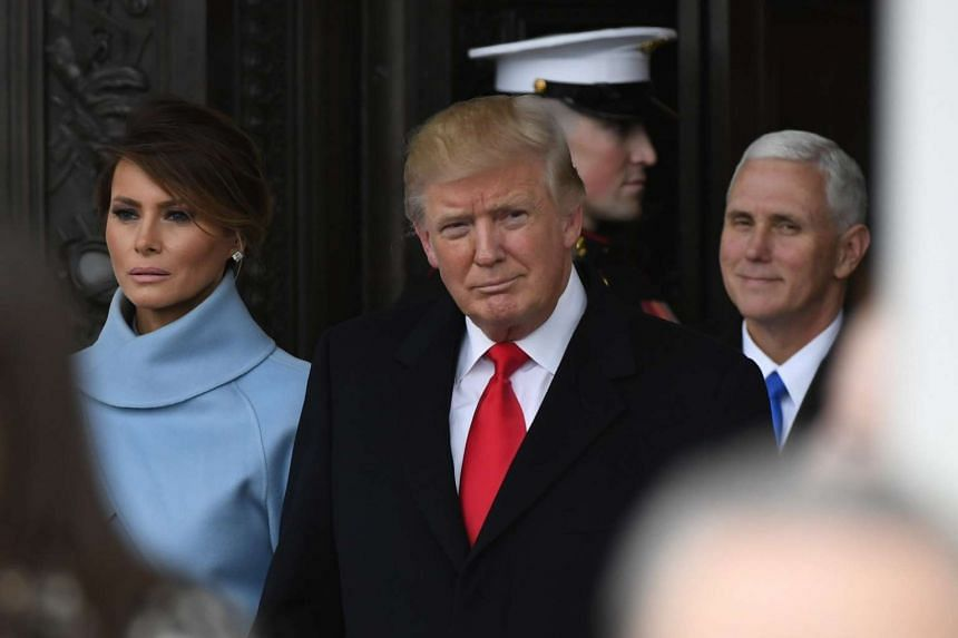 US President Donald Trump and US First Lady Melania Trump (left) depart the Inauguration, Jan 20, 2017.