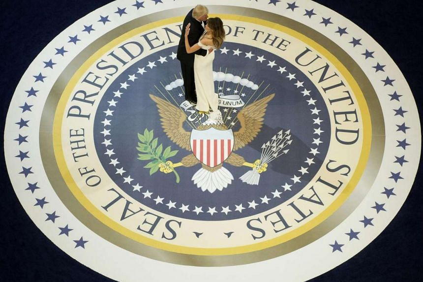 US President Donald Trump and the first lady Melania Trump dance at the Armed Services ball at the National Building museum.
