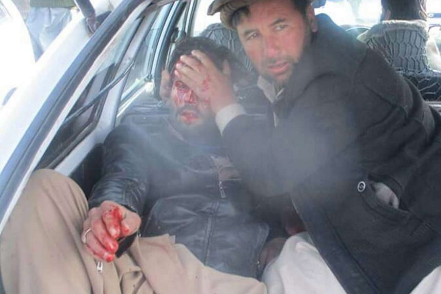 A man who was injured in the bomb blast being rushed to the hospital.