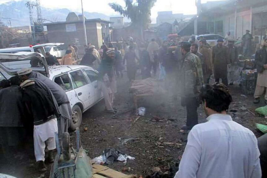 People moving injured victims of the bomb blast.
