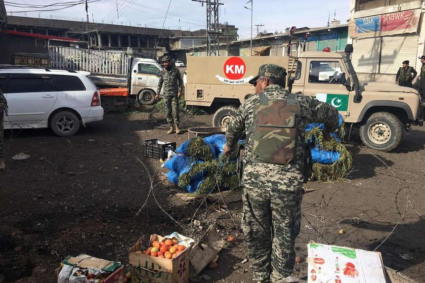 Pakistani security officals inspecting the site of a bomb explosion at a vegetable market in Parachinar city, the capital of Kurram tribal district on the Afghan border, on Jan 21, 2017.