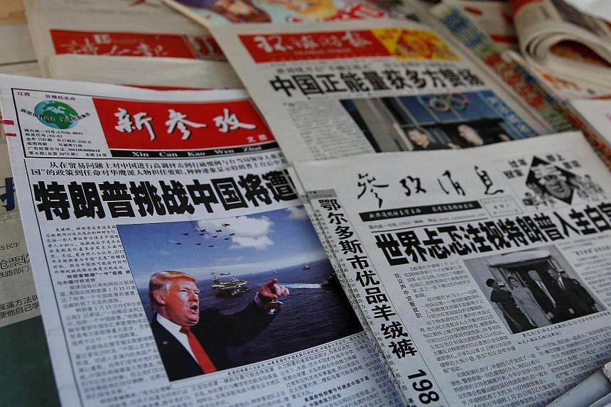 Chinese newspapers showing US President Donald Trump at a newsstand in Shanghai, China on Jan 21, 2017.
