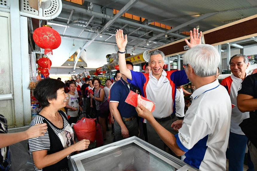 Prime Minister Lee Hsien Loong greeting residents during his walkabout at 341 Ang Mo Kio Ave 1 Market and Food Centre, on Jan 21, 2017.