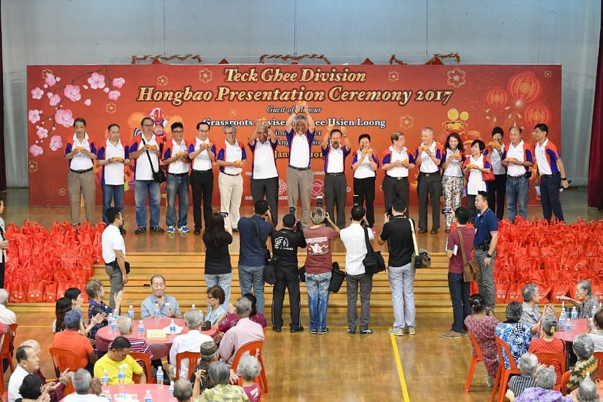 PM Lee Hsien Loong greeting senior citizens at the Teck Ghee Division Hongbao Presentation Ceremony 2017 at Teck Ghee Primary School, on Jan 21, 2017.