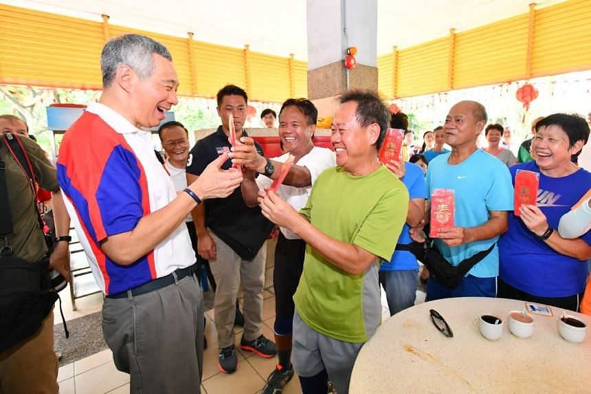 Prime Minister Lee Hsien Loong interacting with residents during his walkabout at 341 Ang Mo Kio Ave 1 Market and Food Centre, on Jan 21, 2017.