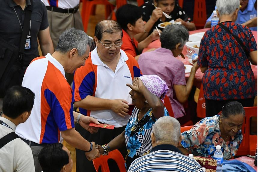 An elderly woman giving PM Lee Hsien Loong a salute while receiving her hongbao, at the Teck Ghee Division Hongbao Presentation Ceremony 2017 at Teck Ghee Primary School on Jan 21, 2017.