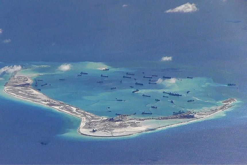 This US Navy surveillance image from 2015 purports to show Chinese dredging vessels in the waters around Mischief Reef, in the South China Sea's disputed Spratly Islands. If the new US administration weakens its engagement in the South China Sea, Bei