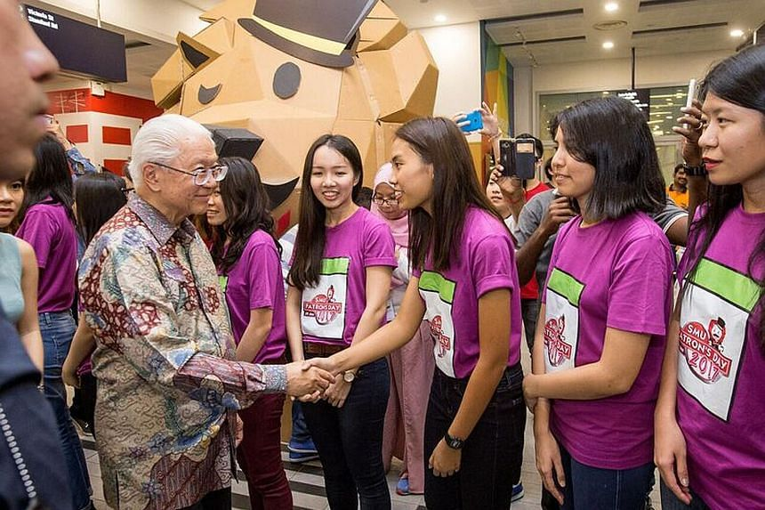 President Tony Tan Keng Yam shaking hands with Singapore Management University (SMU) student Ada Eleora Cheng at the university's annual Patron's Day celebration yesterday. Dr Tan, who is SMU patron, also viewed an exhibition on the SMU Challenge, th