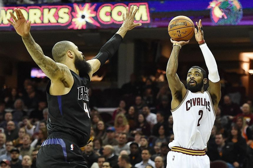 Cleveland Cavaliers point guard Kyrie Irving shooting over Phoenix Suns centre Tyson Chandler in the Cavs' 118-103 win at Quicken Loans Arena in Cleveland on Thursday. Irving (26 points) combined with Cavs superstar LeBron James for 47 points in a co
