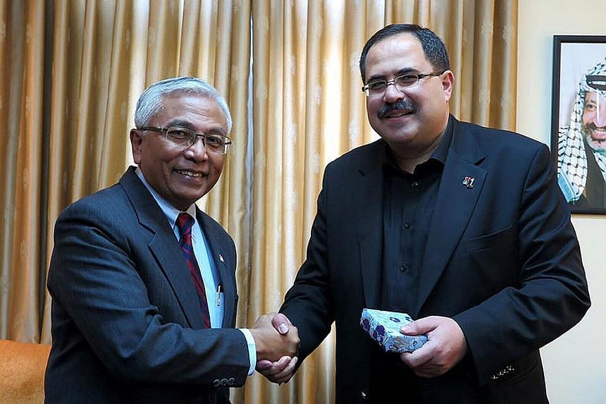 Mr Hawazi Daipi (far left) met Palestinian minister Sabri Saidam, on his first visit to the Palestinian Territories since being appointed Singapore's representative last year.