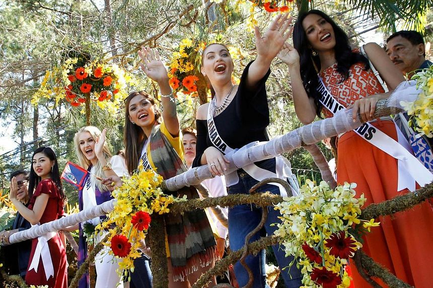 Miss Universe contestants on a float during their arrival and parade in Baguio City in the Philippines on Wednesday. The contestants have been mobbed like rock stars in the Phillipines. Reigning Miss Universe Pia Wurzbach from the Philippines arrivin