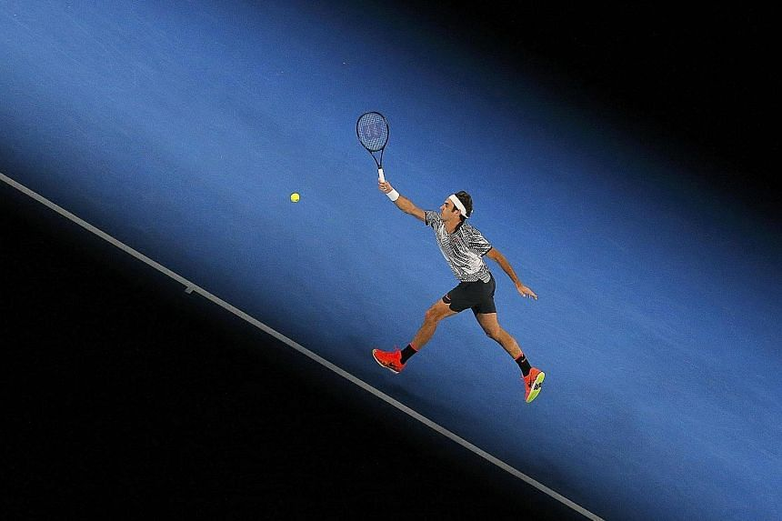 Roger Federer hitting a return to Tomas Berdych in his straight-sets vanquishing of the Czech 10th seed. The Swiss made light work of his third- round opponent, taking just 90 minutes to seal his passage into the fourth round where he will face Japan
