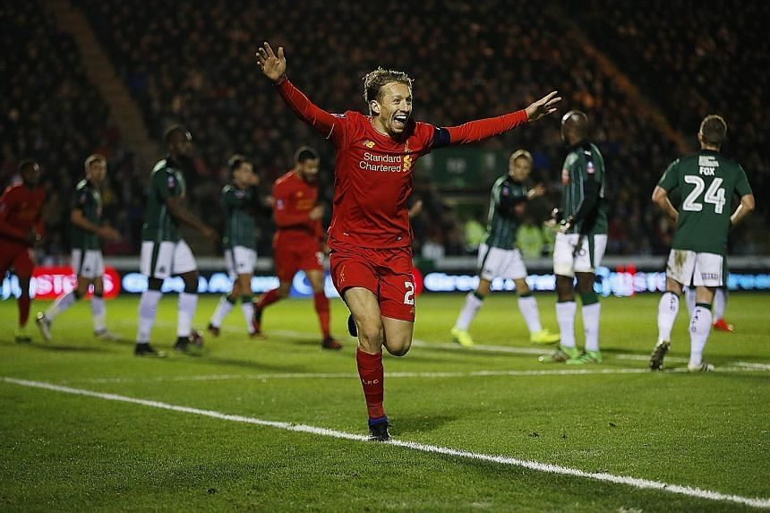 Liverpool's Lucas Leiva celebrating his drought-breaking goal against Plymouth in their FA Cup encounter on Wednesday. The Brazilian headed home from Philippe Coutinho's corner for his first goal in seven years, even as the tug-of-war over his future