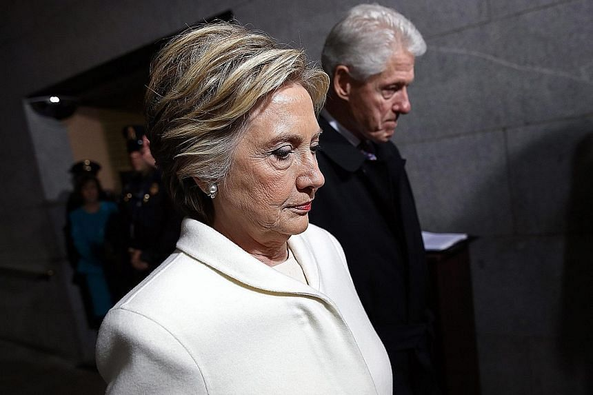 Democratic presidential nominee Hillary Clinton and her husband, former president Bill Clinton, arriving for the inauguration ceremony of Mr Trump yesterday. The West Front of the US Capitol in Washington filling up with guests prior to the swearing-
