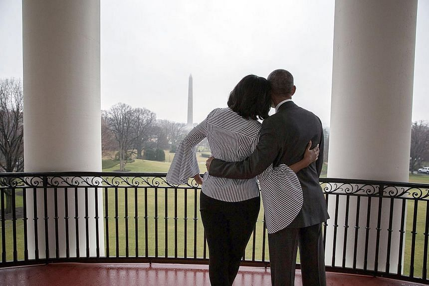 Mrs Obama thanked her supporters on Twitter and shared a picture of herself and Mr Obama enjoying the view from the White House's Truman balcony. Mr Trump greeting the crowds with his family at the Make America Great Again! Welcome Celebration event