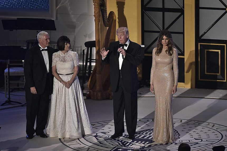 Mr Trump addressing guests during a dinner reception at Union Station on Thursday in Washington, accompanied on stage by (from left) Mr Mike Pence, who was sworn in as Vice-President yesterday, Mrs Karen Pence and Mrs Melania Trump.