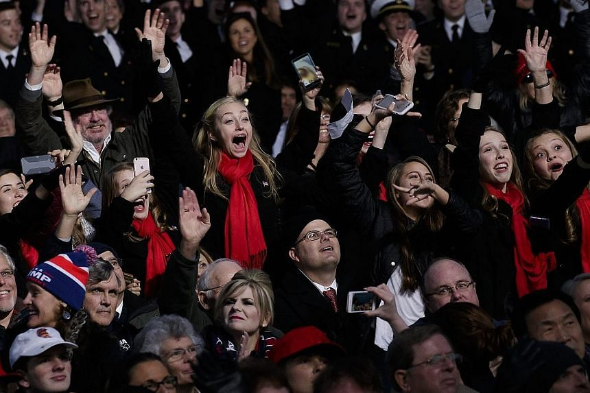 The audience cheering during the Make America Great Again! Welcome Celebration for Mr Trump at the Lincoln Memorial on Thursday that was anchored by country music veterans.