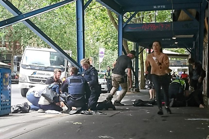 Gargasoulas had allegedly stabbed his brother early yesterday morning before the driving rampage. Police officers and emergency services staff attending to the injured after the car driven by Gargasoulas hit pedestrians in the heart of the shopping d