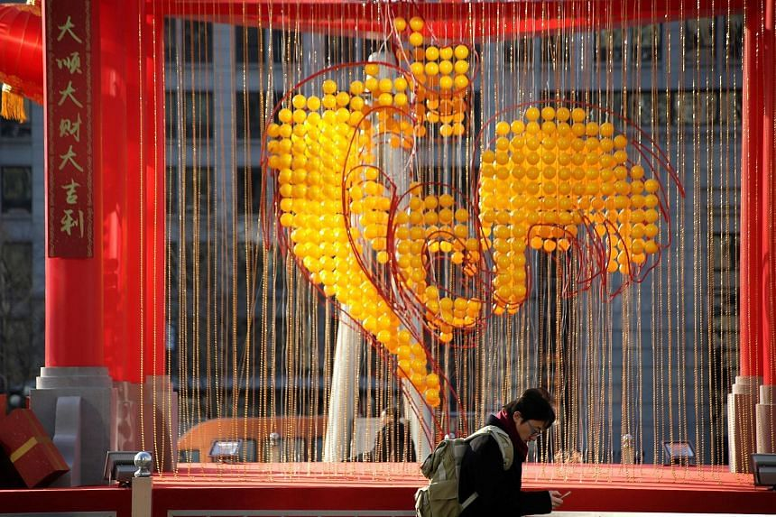 Decorations to celebrate the upcoming Year of the Rooster at Oriental Plaza in Beijing, China. The People's Bank of China has cut the reserve requirement ratio for banks by one percentage point, taking the ratio down to 16 per cent, and it will resto