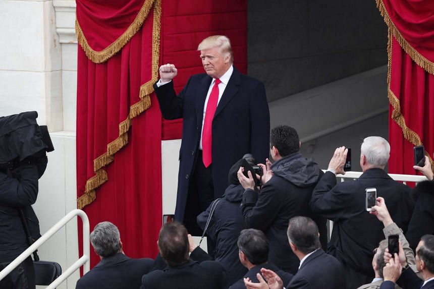 President-elect Donald Trump arrives at the start of his inauguration as the 45th president of the United States at the US Capitol in Washington on Jan 20, 2017.