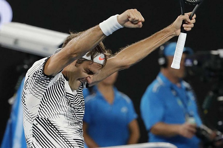 Roger Federer celebrates his win against Kei Nishikori at the Australian Open Grand Slam tennis tournament in Melbourne on Jan 22, 2017.