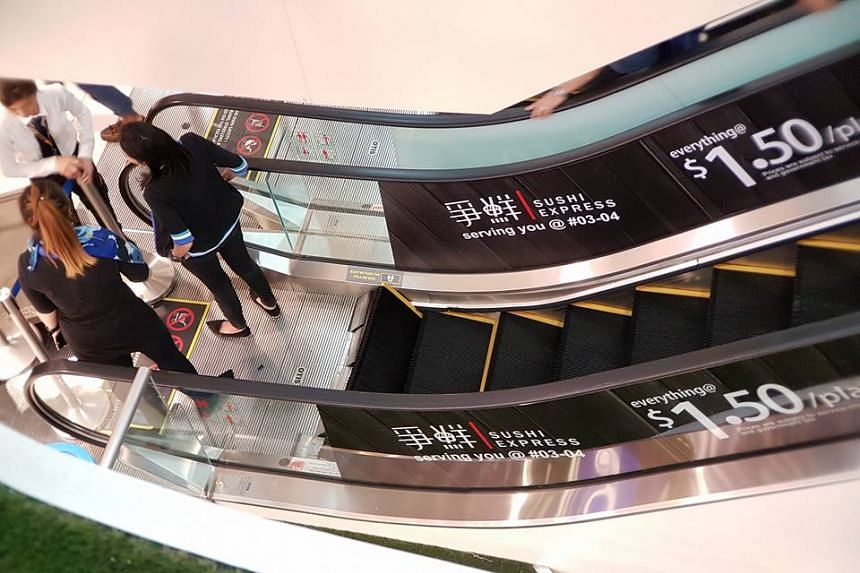 An escalator at White Sands shopping mall was cordoned off after it buckled behind a couple with a baby stroller.