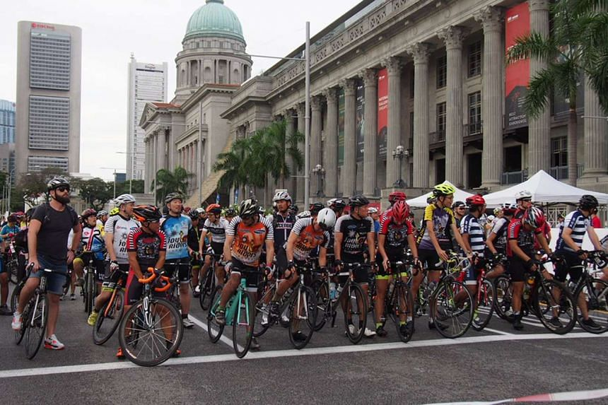 Cyclists wait for the flag-off of the first Car-Free Sunday of the year.