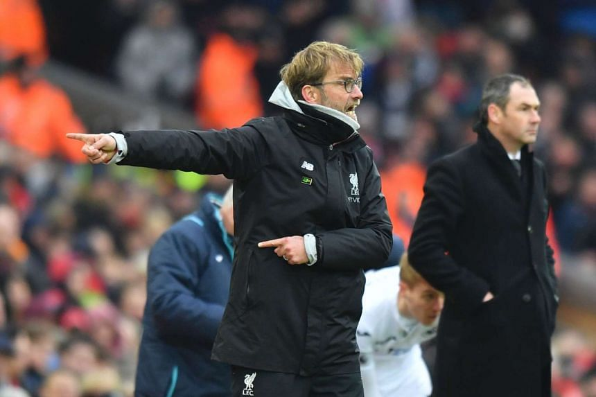 Liverpool's German manager Jurgen Klopp gestures on the touchline during the match.