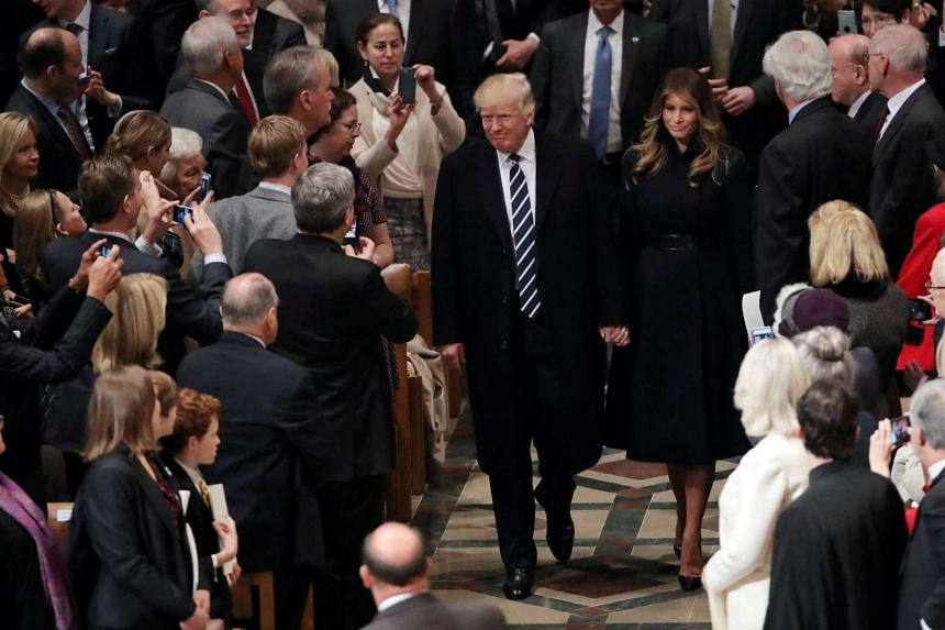 US President Donald Trump and First Lady Melanie Trump arrive for a church service at the National Cathedral in Washington, Jan 21, 2017.