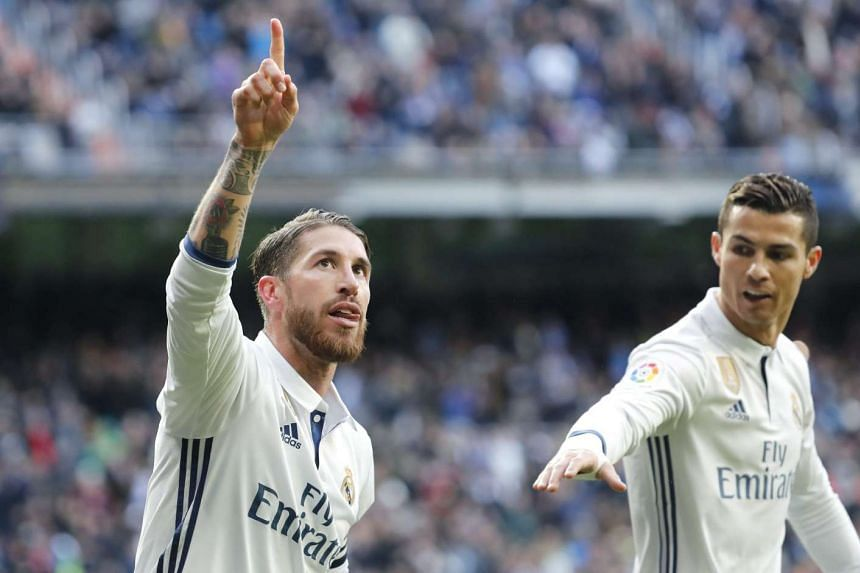 Real Madrid's defender Sergio Ramos (left) celebrates with his teammate Cristiano Ronaldo (right) after scoring.
