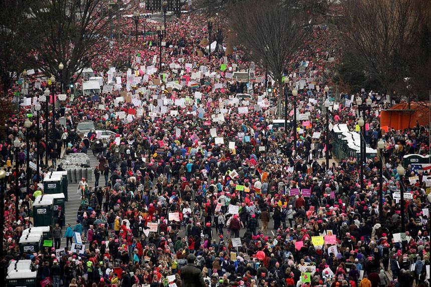 People pack the streets near the National Mall for the start of the Women's March in Washington, Jan 21, 2017.