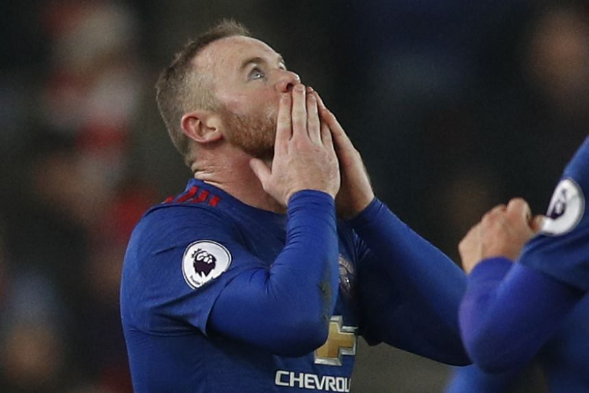 Manchester United's Wayne Rooney celebrates after scoring their first goal to break the all time goalscoring record for Manchester United.