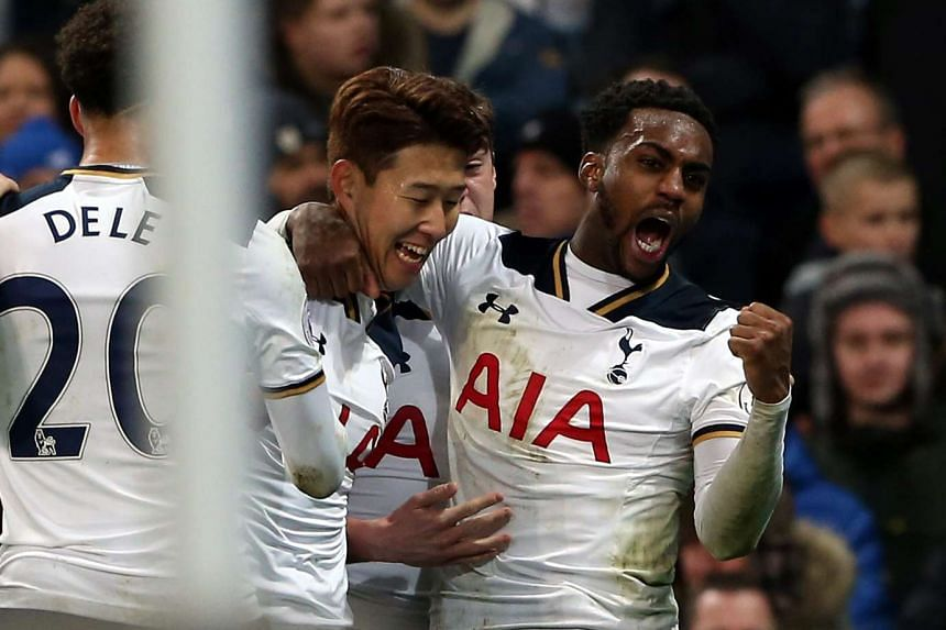 Tottenham Hotspurs' Heung-min Son (centre) celebrates scoring the equalizer with team-mates.