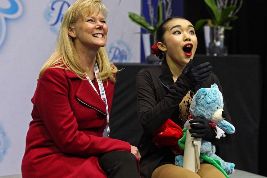 Karen Chen reacts to her score after her free skate performance at the US National Figure Skating Championships in Kansas City on Jan 21, 2017.
